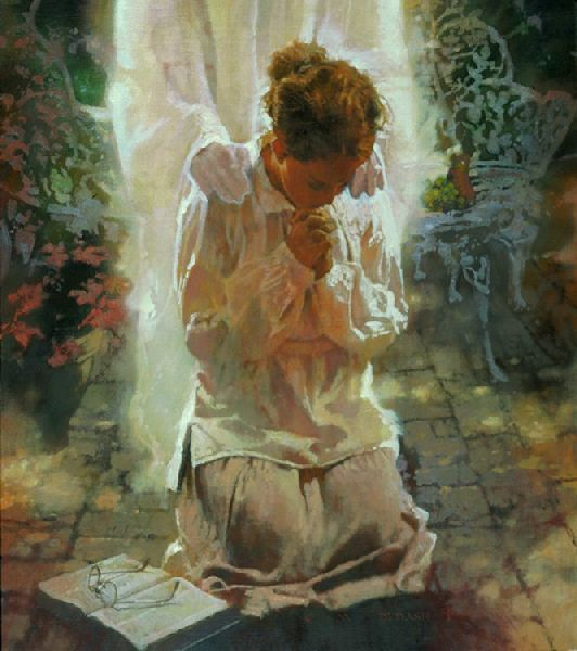 women kneeing in prayer